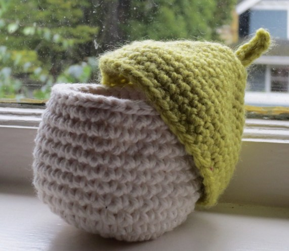 Little Acorn-like Box with Lid Askew and A Dirty Window Behind It