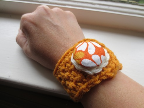 I KNOW that neither of grandpas would have worn this wrist cuff. And not just because the photo makes the button look HUGE and as though it wold weigh one`s whole arm down. Its just a bad shot by a terrible photographer with wrinkly hands.