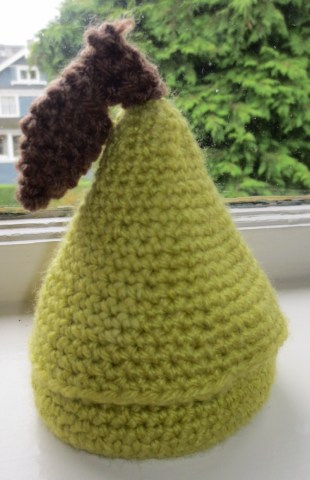 This little pear, at one time, had a little crochet snail inside. That snail is long gone. He is probably under a bookcase that never gets pulled out to vacuum behind because I figure, if I can`t see the dust, neither can anyone else.