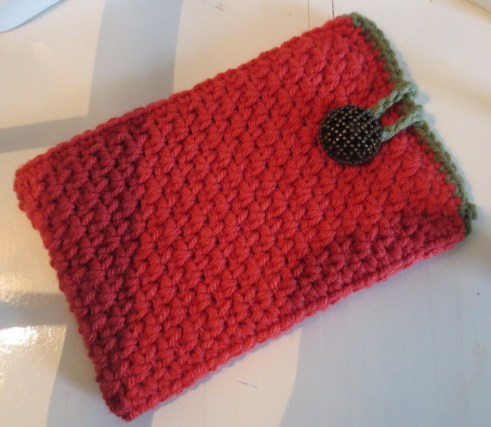 There is only one row of single crochet around the top of this one. It looks much better with two. Trust.