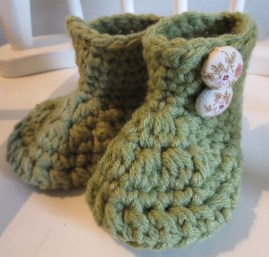 Infant wool boots with hand made fabric buttons.