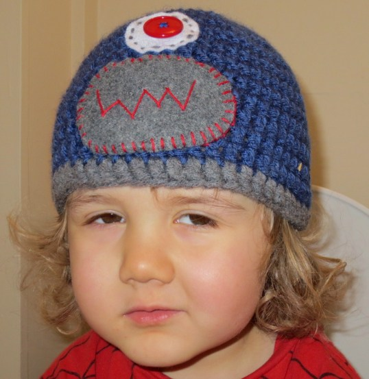 Robot hat on miserable child.