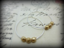 Silver hoop earrings with gold glass